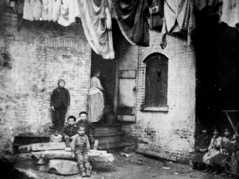 Baxter Street Court, in the Five Points slums of New York in 1895, as photographed by Jacob Riis or one of his four uncredited assistants.